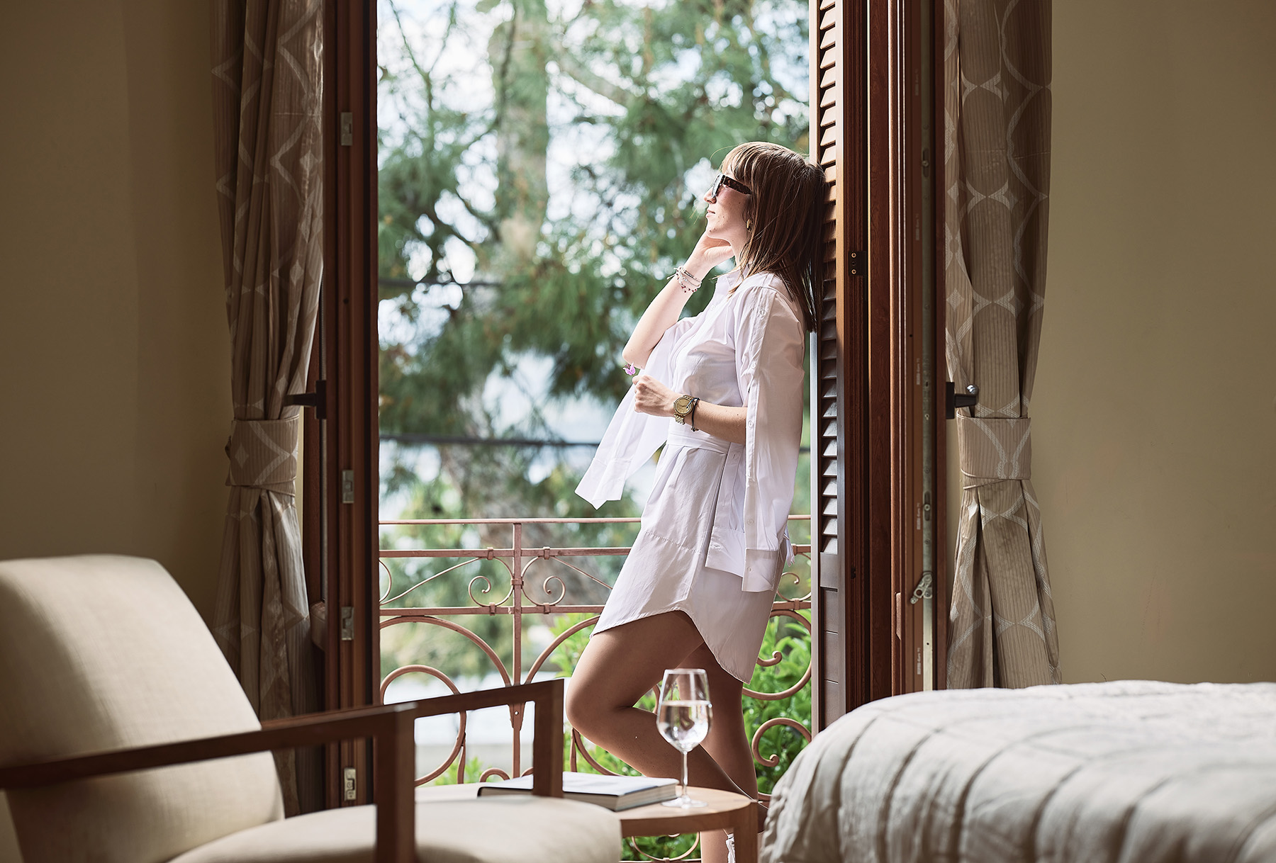 3. aktaion_hotel_edipsos_bedroom_balcony_view_girl_woman_staring_outside_calmness_relax_enjoy_hotelsevoia_booking