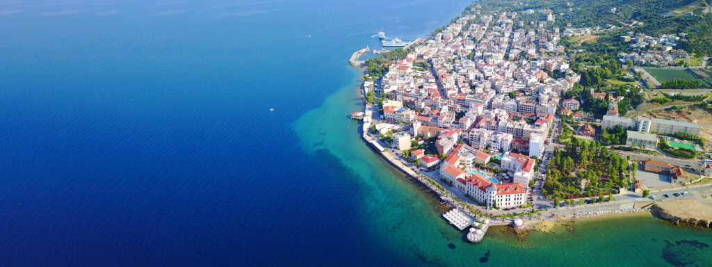 Aerial drone ultra wide photo of famous seaside village well known for thermal springs of Aidipsos, North Evia island, Greece